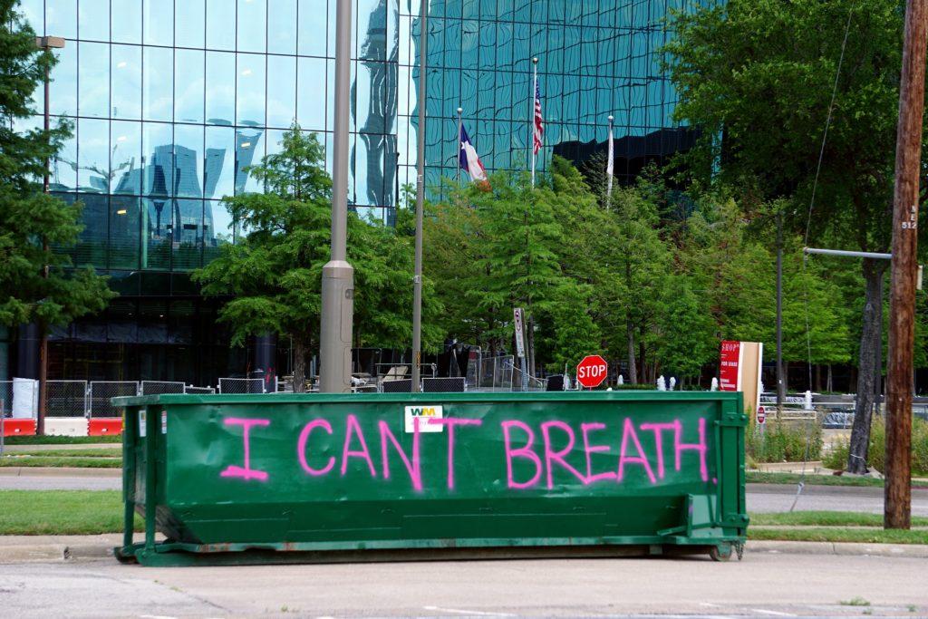 I can't breath - written on a trash dumpster